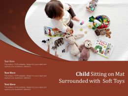 Child Sitting On Mat Surrounded With Soft Toys