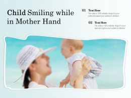 Child Smiling While In Mother Hand