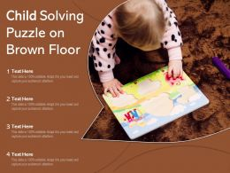 Child Solving Puzzle On Brown Floor