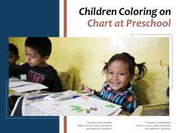 Children Coloring On Chart At Preschool