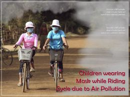 Children Wearing Mask While Riding Cycle Due To Air Pollution