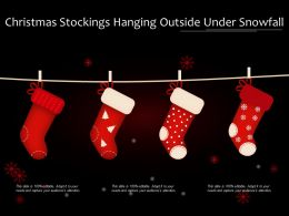 Christmas Stockings Hanging Outside Under Snowfall