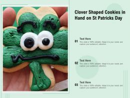 Clover Shaped Cookies In Hand On St Patricks Day