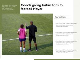 Coach Giving Instructions To Football Player