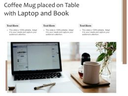 Coffee Mug Placed On Table With Laptop And Book