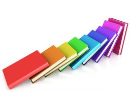 Colored Books Aligned Like Domino Stock Photo