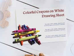 Colorful Crayons On White Drawing Sheet