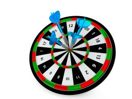 Colorful Dart Showing Target With Arrow Hitting Stock Photo