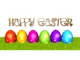 Colorful Eggs On Grass With Happy Easter Message Stock Photo