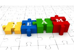 Colorful Puzzles With Word Team White Puzzles Background Stock Photo