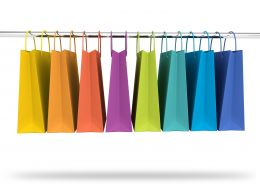 Colorful Shopping Bags In Hanger Stock Photo