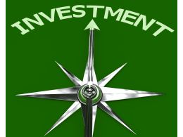 Compass Arrow Pointing To Investment On Green Background Stock Photo