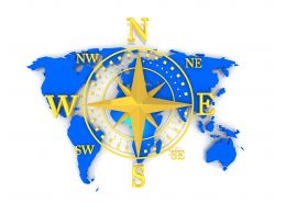 Compass With Directions On World Map Stock Photo