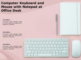 Computer Keyboard And Mouse With Notepad At Office Desk