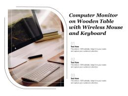 Computer Monitor On Wooden Table With Wireless Mouse And Keyboard