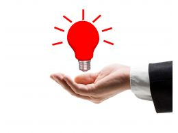 Conceptual Idea Bulb For Innovation On Human Hand Stock Photo