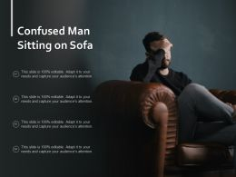 Confused Man Sitting On Sofa