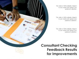 Consultant Checking Feedback Results For Improvements