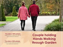 Couple Holding Hands Walking Through Garden