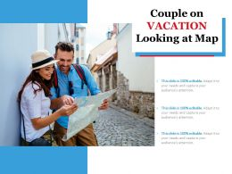 Couple On Vacation Looking At Map