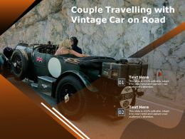 Couple Travelling With Vintage Car On Road