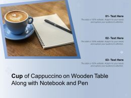 Cup Of Cappuccino On Wooden Table Along With Notebook And Pen