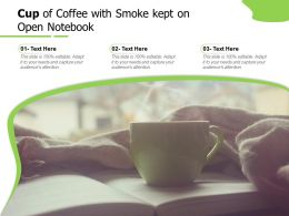 Cup Of Coffee With Smoke Kept On Open Notebook