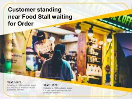 Customer Standing Near Food Stall Waiting For Order