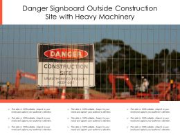 Danger Signboard Outside Construction Site With Heavy Machinery