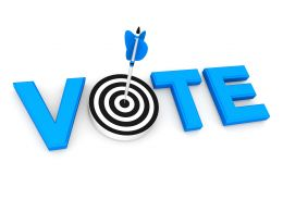 Dartboard With Arrow Inbetween Of Word Vote Displaying Target Achievement Stock Photo