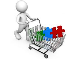 Different Colored Puzzle In Cart With 3D Man Stock Photo