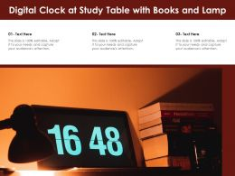 Digital Clock At Study Table With Books And Lamp