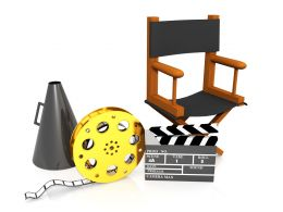 Directors Chair With Clap Board And Megaphone For Movie Shooting Stock Photo