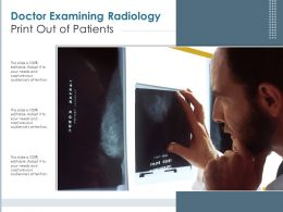 Doctor Examining Radiology Print Out Of Patients