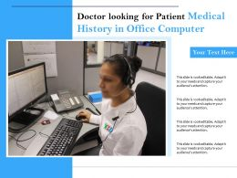 Doctor Looking For Patient Medical History In Office Computer