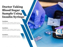 Doctor Taking Blood Sugar Sample Using Insulin Syringe