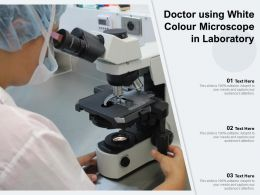Doctor Using White Colour Microscope In Laboratory