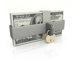 Dollar Bundle With Lock Over Financial Safety Stock Photo