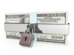 Dollar Bundles Protected With Chain And Clock Stock Photo