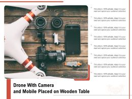 Drone With Camera And Mobile Placed On Wooden Table