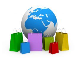 Earth And Shopping Bags With Globe Stock Photo