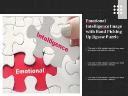 Emotional Intelligence Image With Hand Picking Up Jigsaw Puzzle