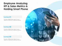 Employee Analyzing KPI And Sales Metrics And Holding Smart Phone