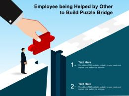 Employee Being Helped By Other To Build Puzzle Bridge