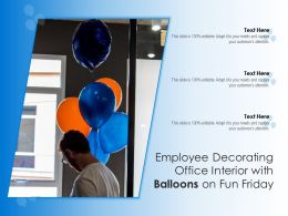 Employee Decorating Office Interior With Balloons On Fun Friday