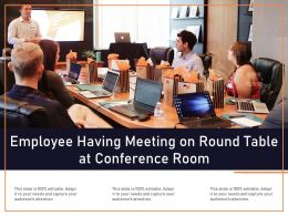 Employee Having Meeting On Round Table At Conference Room