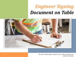 Engineer Signing Document On Table