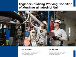 Engineers Auditing Working Condition Of Machine At Industrial Unit