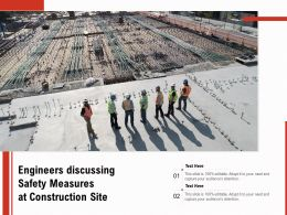 Engineers Discussing Safety Measures At Construction Site