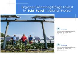 Engineers Reviewing Design Layout For Solar Panel Installation Project
